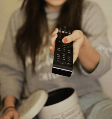 woman using remote