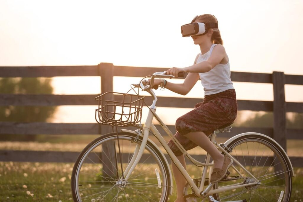Girl on bicycle using AR headset