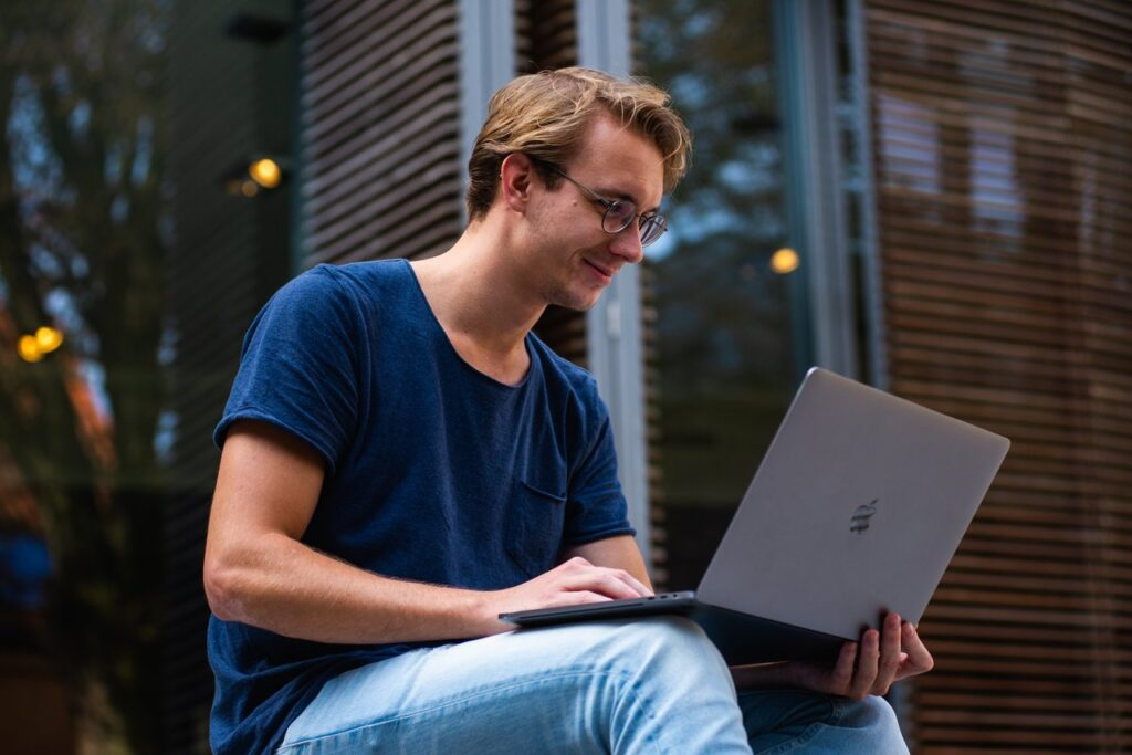 Smiling blogger with laptop